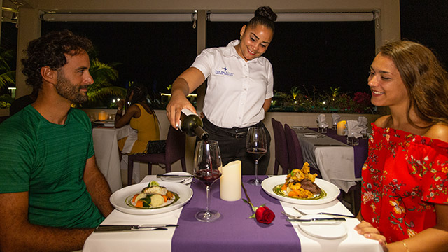 Server Pouring Wine At BLU Bar And Grill At East Bay Resort South Caicos, Turks And Caicos