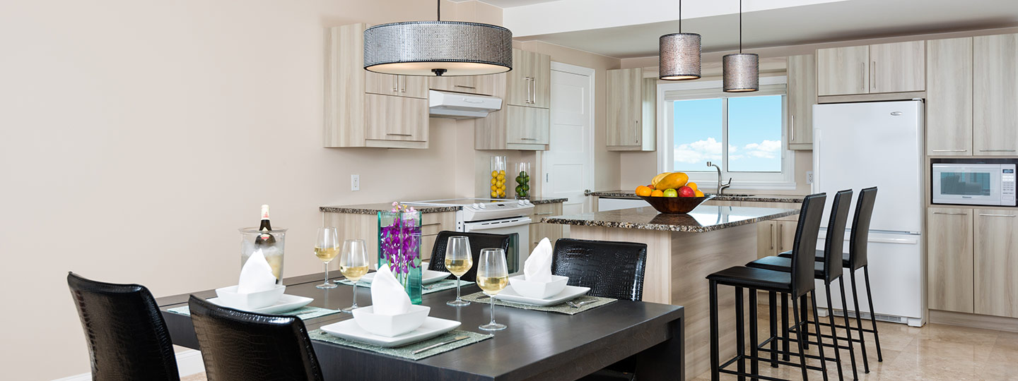 Kitchen And Dining Area In One Bedroom Deluxe Beachfront Suite At East Bay Resort South Caicos, Turks And Caicos