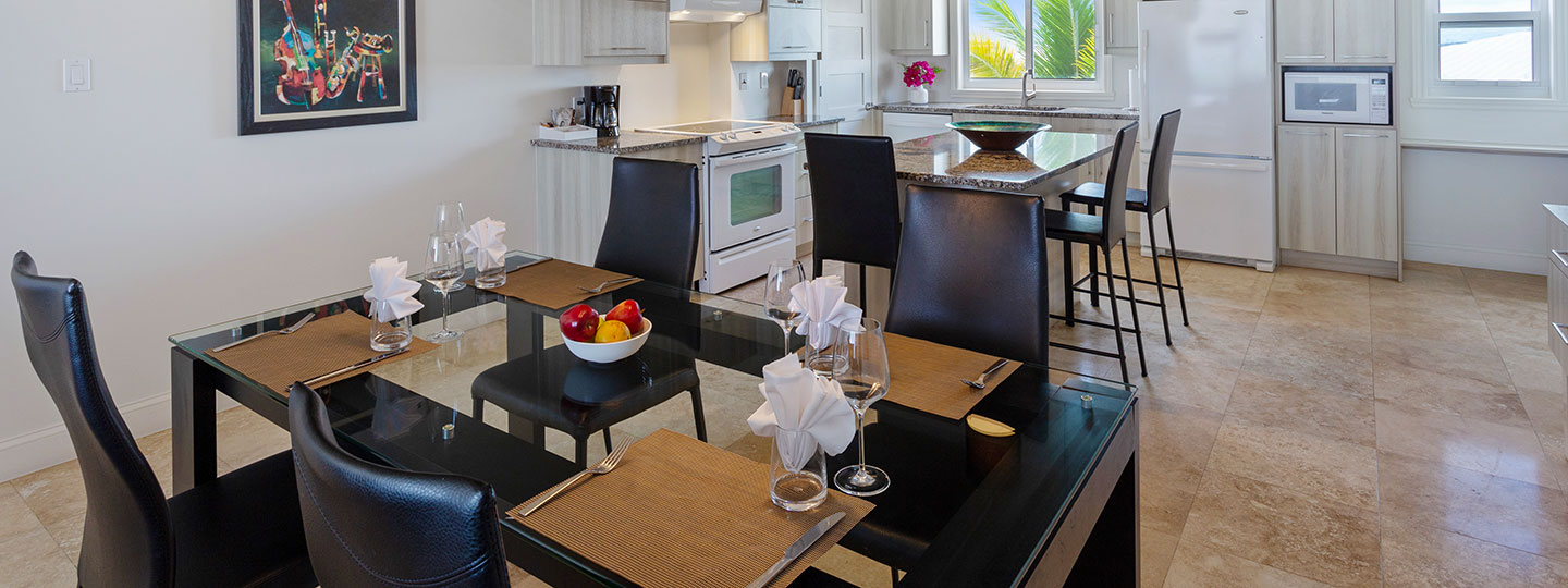 Two Corner Beachfront Suite Dining Room And Kitchen At East Bay Resort South Caicos, Turks And Caicos