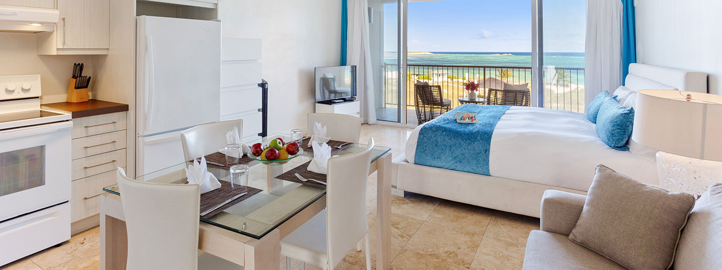 Beachfront Suite Bedroom, Kitchen An Living Room At East Bay Resort South Caicos, Turks And Caicos