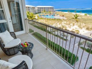 Two Bedroom Deluxe Beachfront Suite Balcony - East Bay Resort