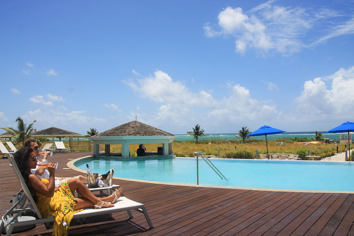 Lounging By The Pool at East Bay Resort