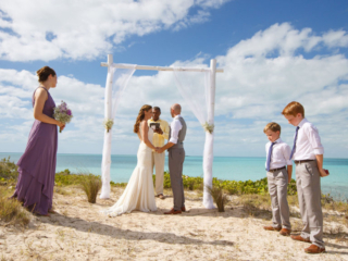 The Bride and Groom Say Their Vows During Their Wedding Ceremony At East Bay Resort