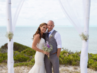 The Bride and Groom Pose Together After Their Wedding Ceremony At East Bay Resort
