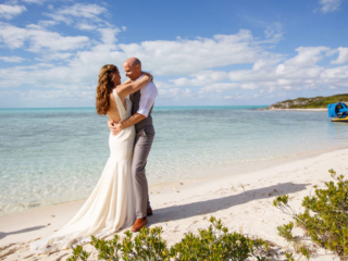 The Bride and Groom Pose For Pictures After Their Wedding Ceremony At East Bay Resort