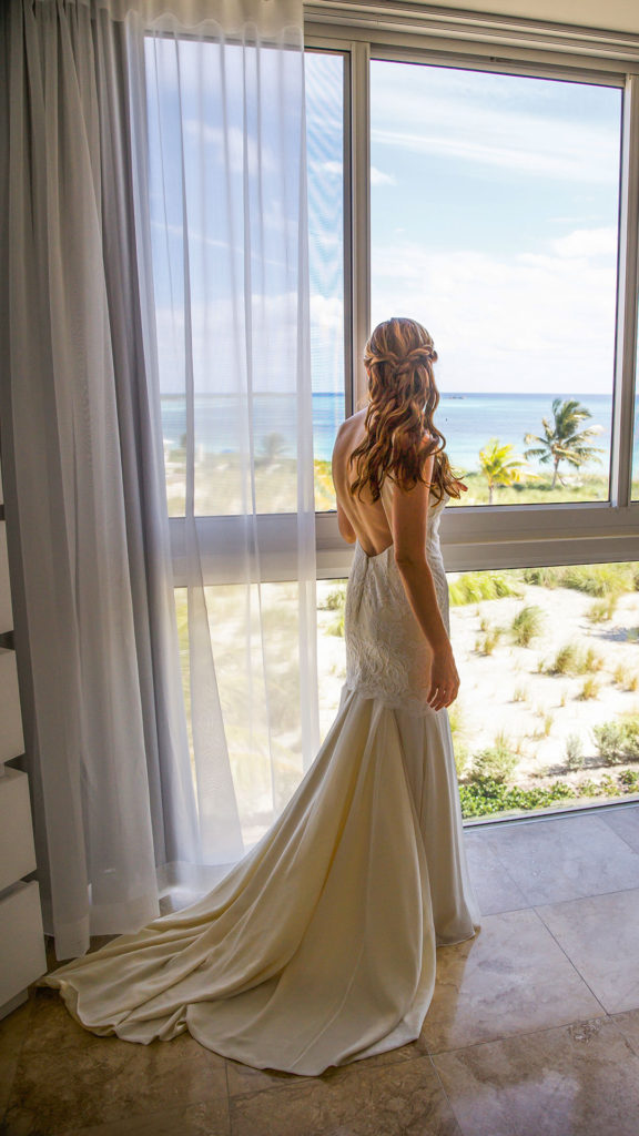 The Bride Looks Out The Window Before Her Ceremony At East Bay Resort