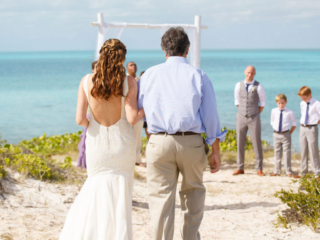 The Bride and Her Father Approach The Wedding Ceremony Spot