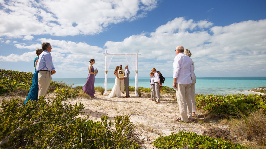 Family and Guests Gather To Hear The wedding Ceremony - At East Bay Resort