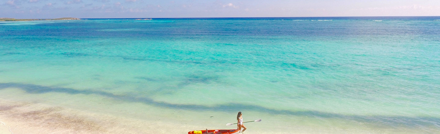 East Bay Beach Kayaker and Beautiful Blue Water, South Caicos, Turks and Caicos
