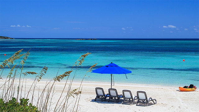 East Bay Beach, Blue Umbrella, Beach Chairs and Kayak South Caicos, Turks and Caicos